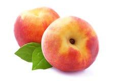 Ripe peach with leaf Stock Photos