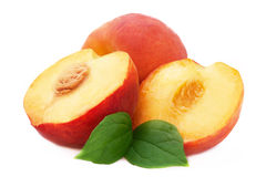 Ripe peach with leaf Royalty Free Stock Image