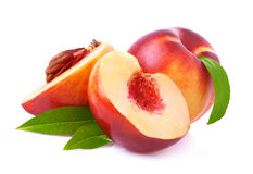 Ripe peach with leaf. Royalty Free Stock Photos