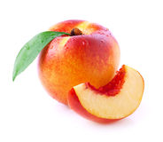 Ripe peach with leaf. Royalty Free Stock Images