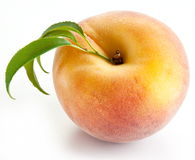 Ripe peach with leaves Royalty Free Stock Image