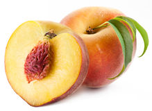 Ripe peach with leaves royalty free stock photos