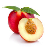 Ripe peach (nectarine) fruit with slices isolated on white Royalty Free Stock Image