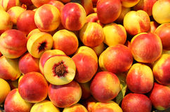 Ripe peach. On pile and one is cut in half Stock Photography