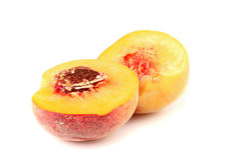 Ripe peach sliced in half Stock Photo