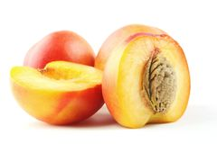 Ripe peaches. Isolated on white background. Whole and half of peach nectarine with drupe Royalty Free Stock Photos