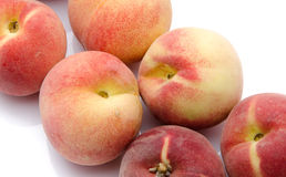 Ripe peaches aligned diagonally Royalty Free Stock Images