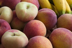 Ripe peaches and bananas Royalty Free Stock Images