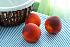 Ripe peaches and basket Stock Photo