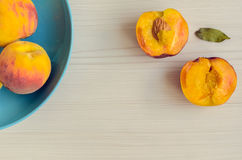Ripe peaches in blue bowl Royalty Free Stock Photo
