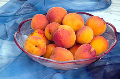 Ripe peaches in a bowl on the table Stock Images