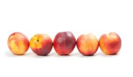 Ripe peaches fruits isolated on white Royalty Free Stock Photos