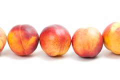 Ripe peaches fruits isolated on white Stock Images