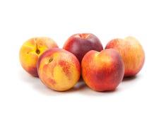 Ripe peaches fruits isolated on white Stock Photo