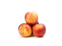 Ripe peaches fruits isolated on white Stock Image