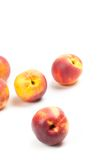 Ripe peaches fruits isolated on white Stock Photography