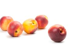 Ripe peaches fruits isolated on white Stock Photos