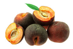 Ripe peaches with green leaf isolated on white Royalty Free Stock Photo