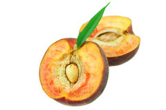 Ripe peaches with green leaf isolated on white Royalty Free Stock Image