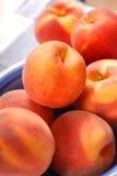 Ripe Peaches In A Blue Bowl Stock Photo