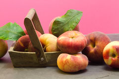 Ripe peaches over wood basket Royalty Free Stock Photography