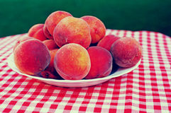 Ripe Peaches on a Plate Royalty Free Stock Images