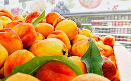 Ripe peaches. Shelf at supermarket with ripe peaches Royalty Free Stock Images