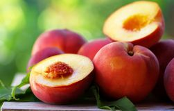 Ripe peaches and slices on table royalty free stock photo