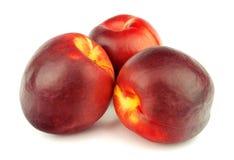 Ripe peaches on white background Stock Photo