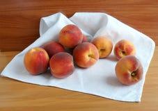 Ripe peaches on a white napkin Royalty Free Stock Photo