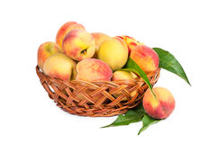Ripe peaches in a wicker basket Royalty Free Stock Image