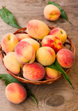 Ripe peaches in a wicker basket Stock Photography