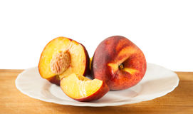 Ripe peaches on the wooden background, selective focus Royalty Free Stock Photo