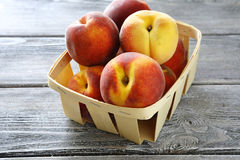 Ripe peaches in wooden box Stock Image