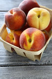 Ripe peaches in a wooden crate Royalty Free Stock Images