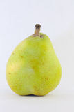 Ripe Pear. A Green and Yellow Pear with Stem Stock Photo
