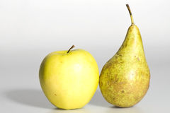 Ripe pear and apple. Isolated on a white background Royalty Free Stock Images