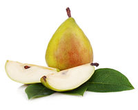 Ripe pear with cut and green leaves isolated on white background Royalty Free Stock Photography