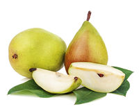 Ripe pear with cut and green leaves isolated on white background Stock Images