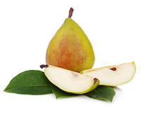 Ripe pear with cut and green leaves isolated on white background Royalty Free Stock Photo