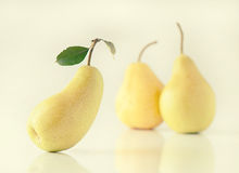 Ripe pear with green leaf on background pears Royalty Free Stock Photo