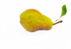 Ripe pear with leaf. Single whole ripe yellow pear with leaf, isolated on white background Stock Photos
