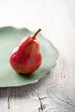 Ripe pear on the plate Stock Photo