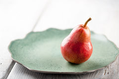 Ripe pear on the plate Stock Photography