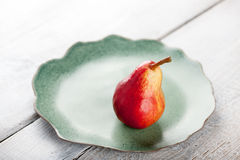 Ripe pear on the plate Royalty Free Stock Images