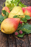 Ripe pear and raspberry Stock Photos