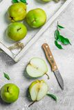 Ripe pear in the tray with a knife. On white rustic background stock images
