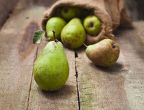 Ripe pear on a wooden background Stock Photography