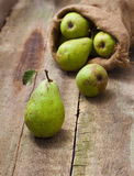 Ripe pear on a wooden background Stock Images