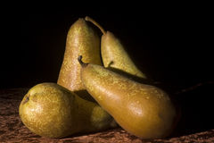 Ripe pears. Group of ripe pears isolated with black background Stock Image